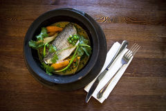 Dorado with vegetables. Dorado steamed with vegetables in a clay plate Stock Images