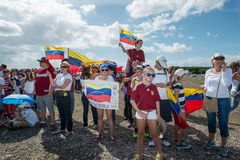 SOS Venezuela Protest. Doral, Miami / United States - February 22 2014: Protestors gather at a rally in Doral, Miami, to raise concerns about the worsening stock photography