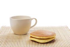 Dorayaki teatime. Dorayaki and teacup on bamboo mattress, clipping paths Stock Photography