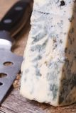 Dorblu cheese close up on an old wooden table Stock Photography