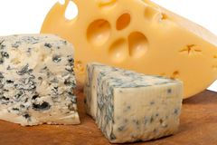 Dorblu and other cheeses on wooden board Royalty Free Stock Photography