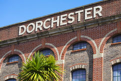 Dorchester in Dorset. Dorchester sign on the exterior of the old Dorchester Brewery building in Brewery Square, Dorchester, Dorset, UK Royalty Free Stock Photos