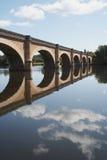 Dordogne River Bridge. Bridge crossing the Dordogne River in France. Sky and bridge reflecting in water Stock Photo