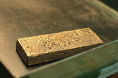 Dore gold bar. After secondary smelting Royalty Free Stock Images