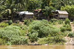 Dorf auf Mekong-Fluss, Laos Stockfotos