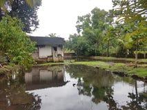 Dorf-Monsun-Haus stockbild