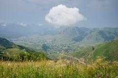 Dorflandschaft und -wolke Lizenzfreies Stockfoto