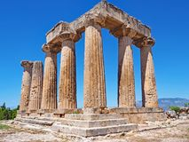 Temple of Apollo at the Archaeological Park of Ancient Corinth in Greece. The doric columns of the Temple of Apollo at the site of Ancient Corinth in Greece Royalty Free Stock Photos