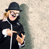 Dorky businessman texting on mobile smart phone. Funny grunge portrait of a geek businessman having difficulty with modern technology when text messaging on Royalty Free Stock Photos