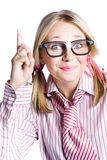 Brainy Business Woman Pointing Up To Great Idea. Dorky Businesswoman Wearing Taped Glasses And Striped Stereotype Shirt And Tie Gesturing A Inventive Idea Stock Image