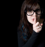 Dorky girl signaling for quiet Royalty Free Stock Photo