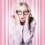 Speechless nerd covering ears in silent shock Stock Images