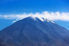 Dormant volcano. On the background of the sky stock photo