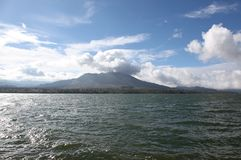 Dormant volcano on the lake Royalty Free Stock Photos