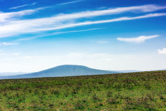 Volcano. Old dormant volcano. Green grass on highlands Stock Image