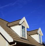 Dormer. And roof against bright blue sky Royalty Free Stock Photography