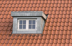 Dormer. Roof with red tiling and dormer Stock Photo