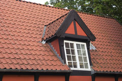 Dormer. Roof with red tiling and dormer Stock Photos