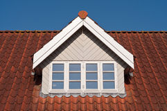 Dormer. On a red roof Royalty Free Stock Photography