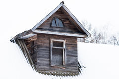 Dormer in an old wooden house Stock Photography