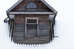 Dormer in an old wooden house Stock Photo