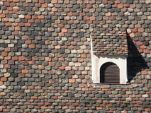 Dormer on Roof with beaver tail tiles. Dormer on roof Beaver tail tiles on a historic house in Strasbourg / France Royalty Free Stock Image