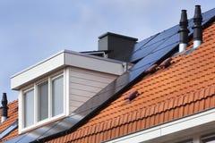 Dormer and solar panels Stock Photo