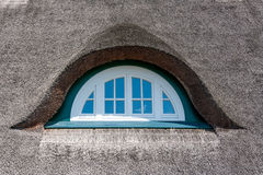 Dormer of a thatched-roof house Stock Images