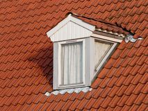Dormer window. On a red tile roof Stock Photography