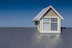Dormer window. Large dormer window on aluminum roof Stock Photo