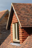 Dormer Window. A dormer window on a house, fully tiled and shows scallop cut lead work Stock Images