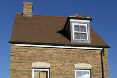 Dormer window. New housing estate in Swindon, Wiltshire, UK. Rather than having houses built in the same style, modern luxury estates utilise a mix of styles and Royalty Free Stock Images