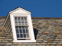 Dormer Window. On the left, with slate roof tiles Stock Image