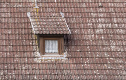 Dormer with window. Detail of a old roof with dormer and  window Royalty Free Stock Photos
