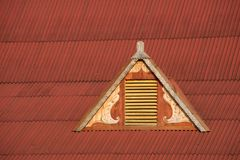Dormer window in red corrugated iron roof Stock Photo