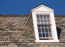 Dormer Window - Right Side. Dormer window on the right, with slate roof tiles Royalty Free Stock Photos