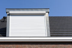 Dormer window with rolling safety  shutter Stock Images