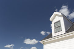 Dormer Window and Roof of House Against Deep Blue Sky Royalty Free Stock Image