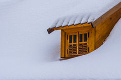 Dormer window on a snow covered roof Royalty Free Stock Photography