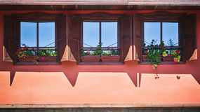 Dormer Windows with Flowers Royalty Free Stock Photos