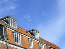 Dormers on building. Rooftop with attics royalty free stock photos