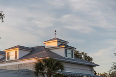 Dormers and Metal Roof in Dusk Light Stock Images