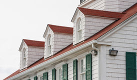 Dormers on Red Roof with Green Shutters Stock Photo
