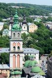 Dormition or Assumption Church,Lvov,Ukraine. Dormition or Assumption Church with the 400 years old Korniakt Tower,Lvov,Ukraine.View from city hall.Historical Stock Image