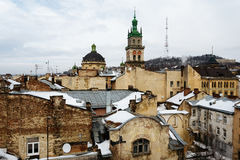Dormition Church above the old houses in the center of Lviv, Ukraine in winter day. Stock Photography