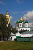 Dormition orthodox church and yellow bell tower. Sunny day. Stock Images