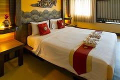 Dormitorio adornado con estilo tradicional tailandés septentrional en un hotel del negocio Imagenes de archivo