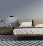 Dormitorio azul con la lámpara de mesa y las tejas Foto de archivo libre de regalías