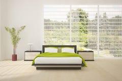 Dormitorio coloreado interior con muebles modernos Imagen de archivo libre de regalías