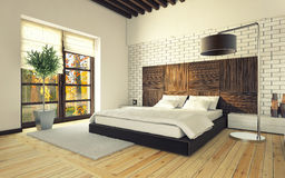Dormitorio con la pared de ladrillo Imagen de archivo